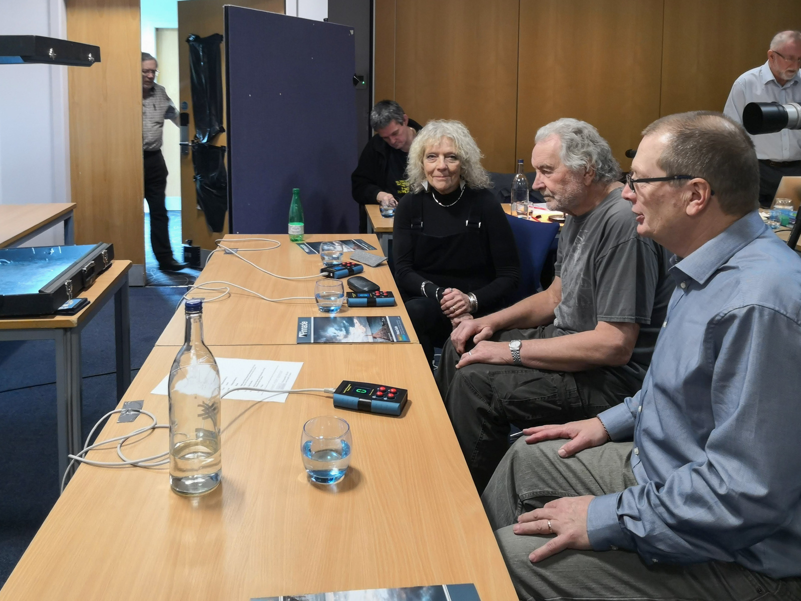 Judges at their desk, with scoring devices at the ready